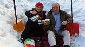 couple enjoying a cup of tea in the snow