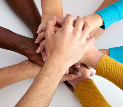 Multi-ethnic hands in a circle